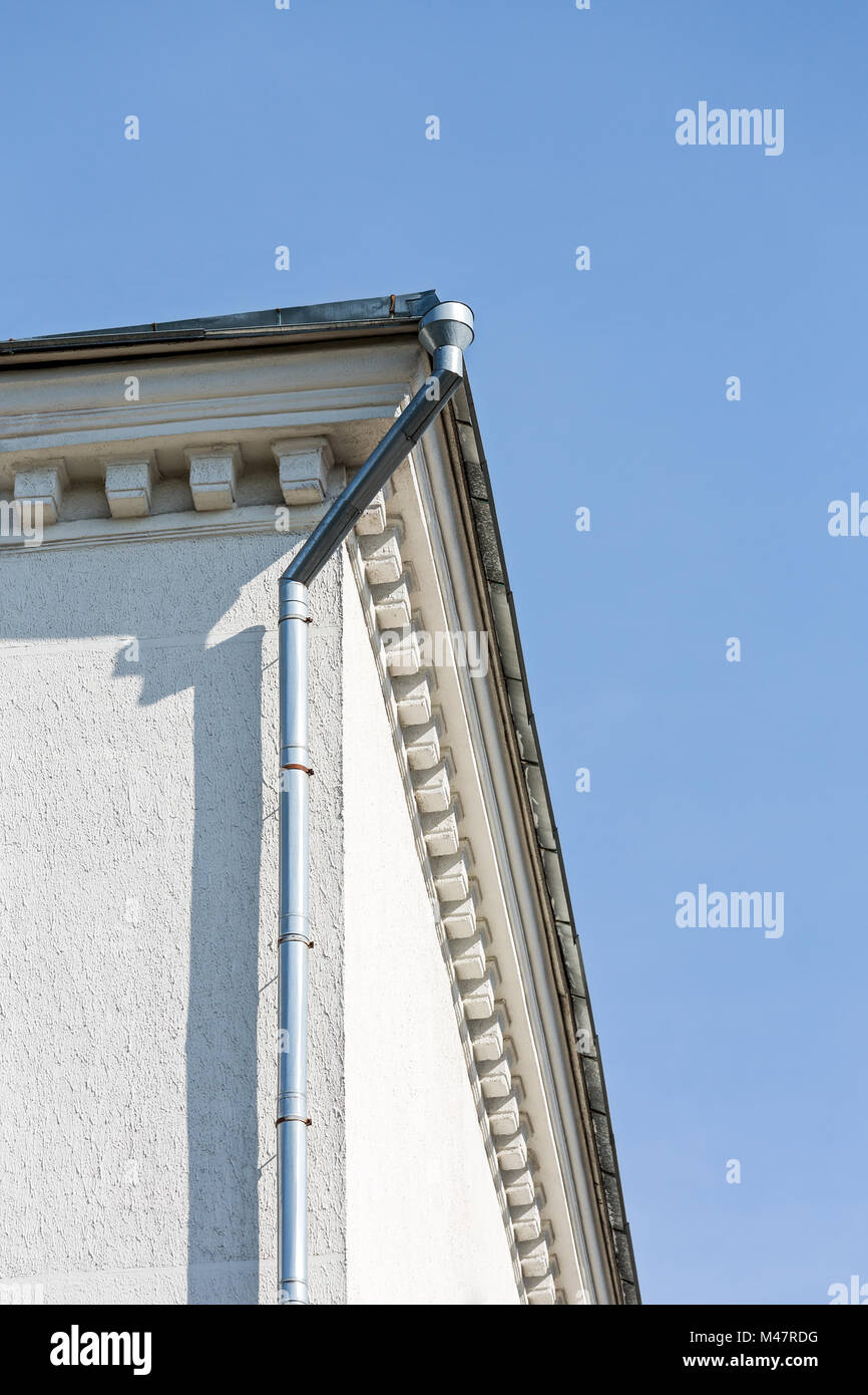 galvanized gutter and downspout - Stock Image
