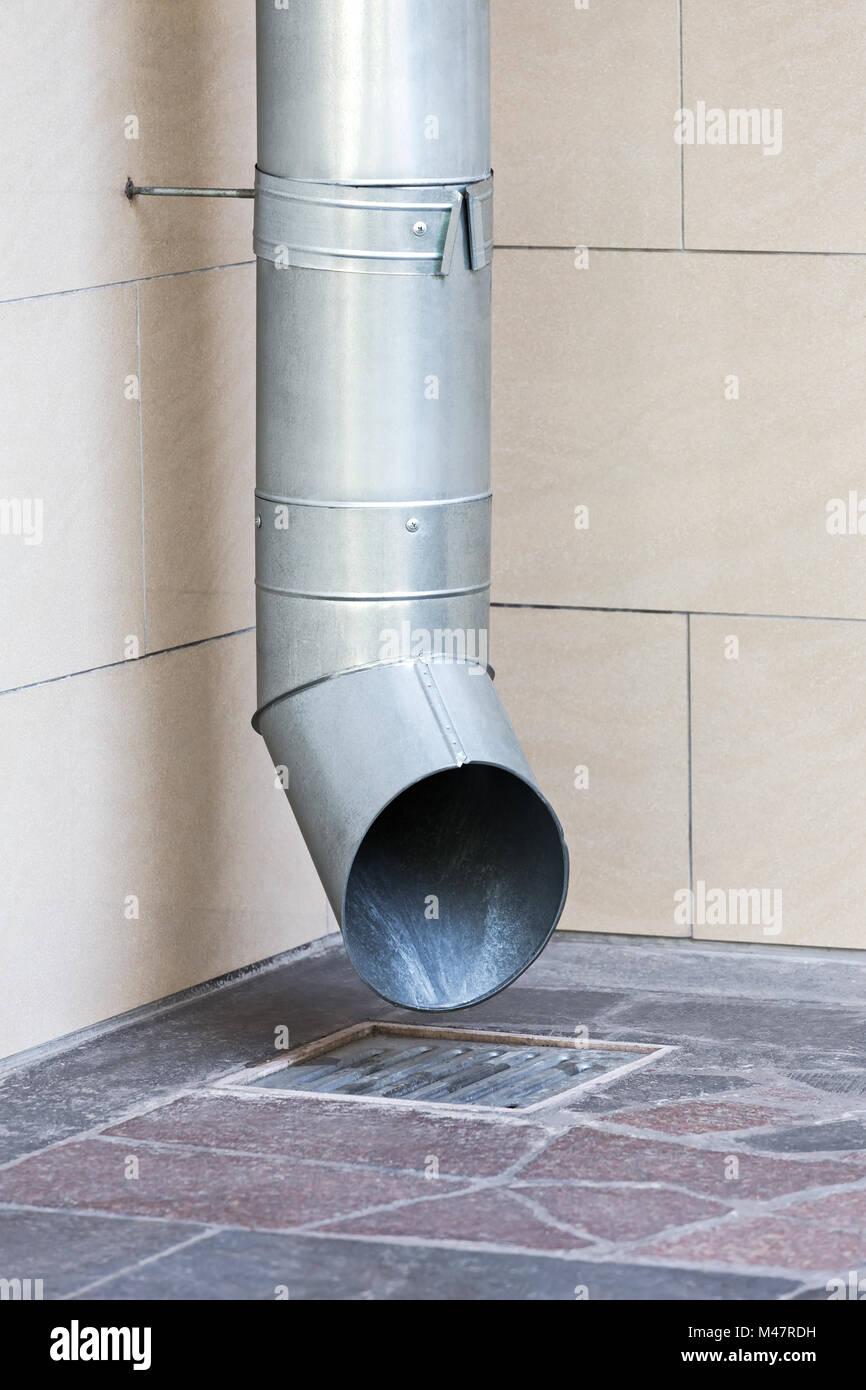 galvanized rainwater drainpipe - Stock Image