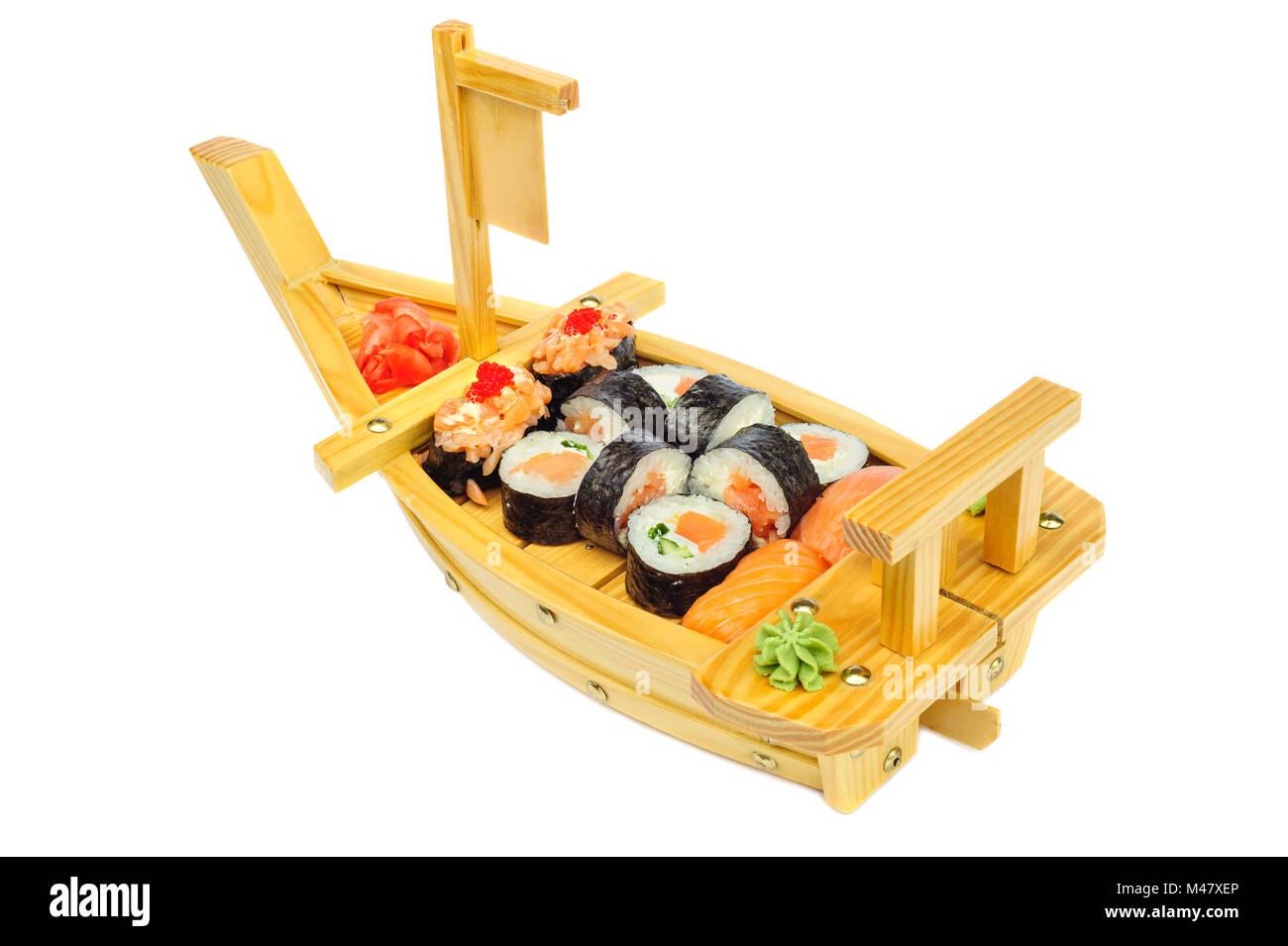 Sushi set of rolls on ship shaped plate Stock Photo