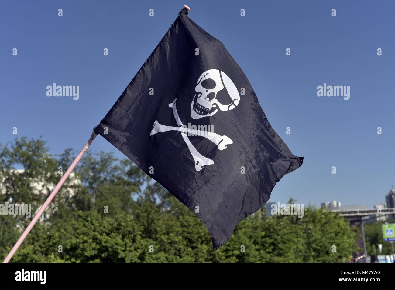 Pirate flag flying in the festival of youth culture - Stock Image