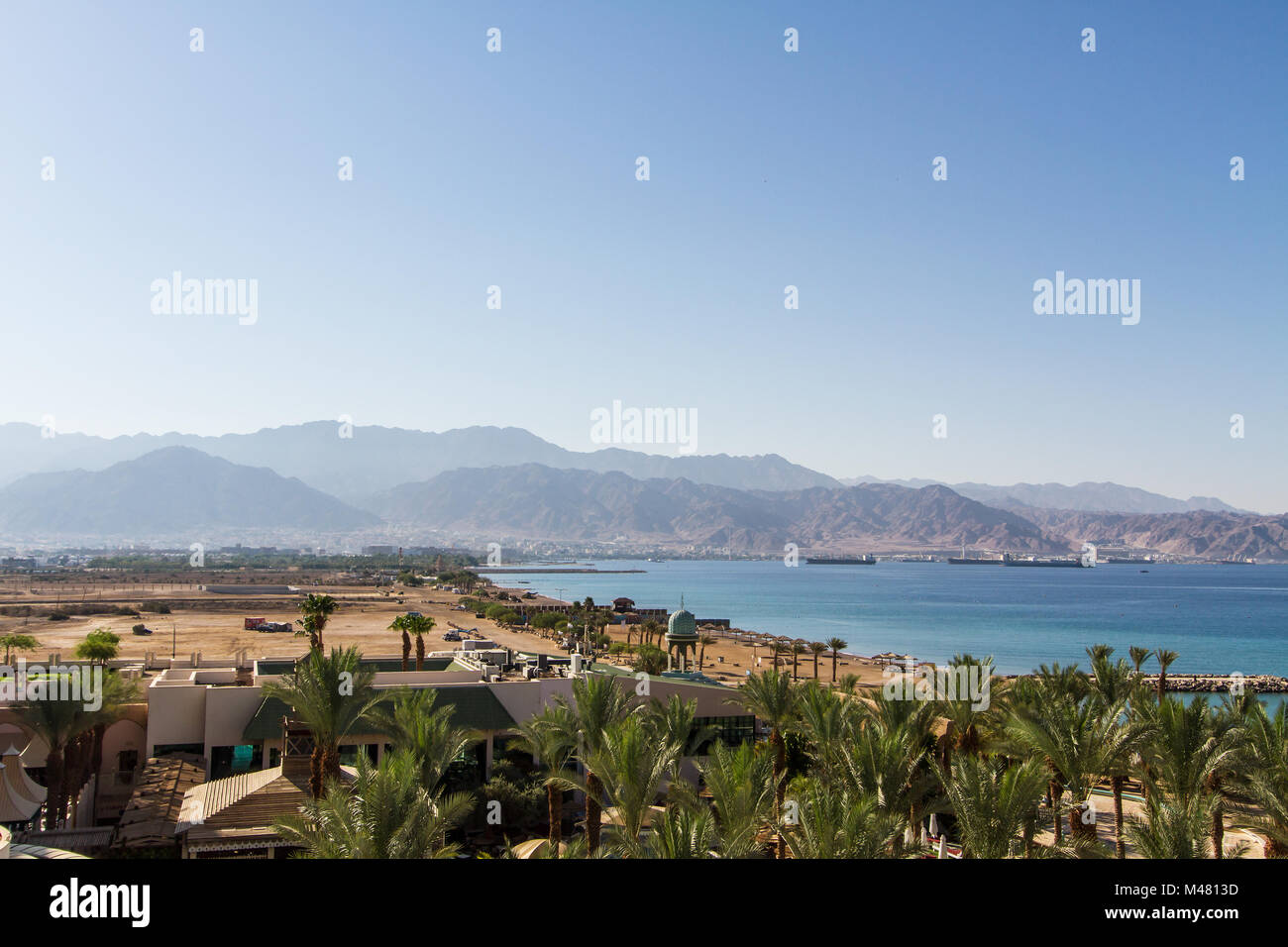 Panoramic view on Aqaba from central beach of Eilat . - Stock Image