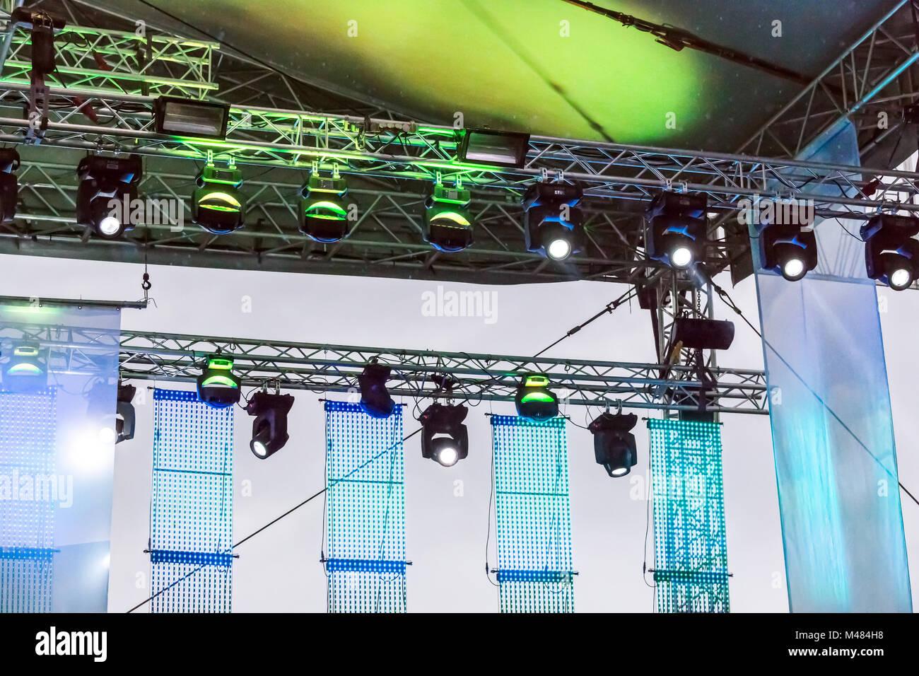 rows spotlights illuminate outdoor stage - Stock Image