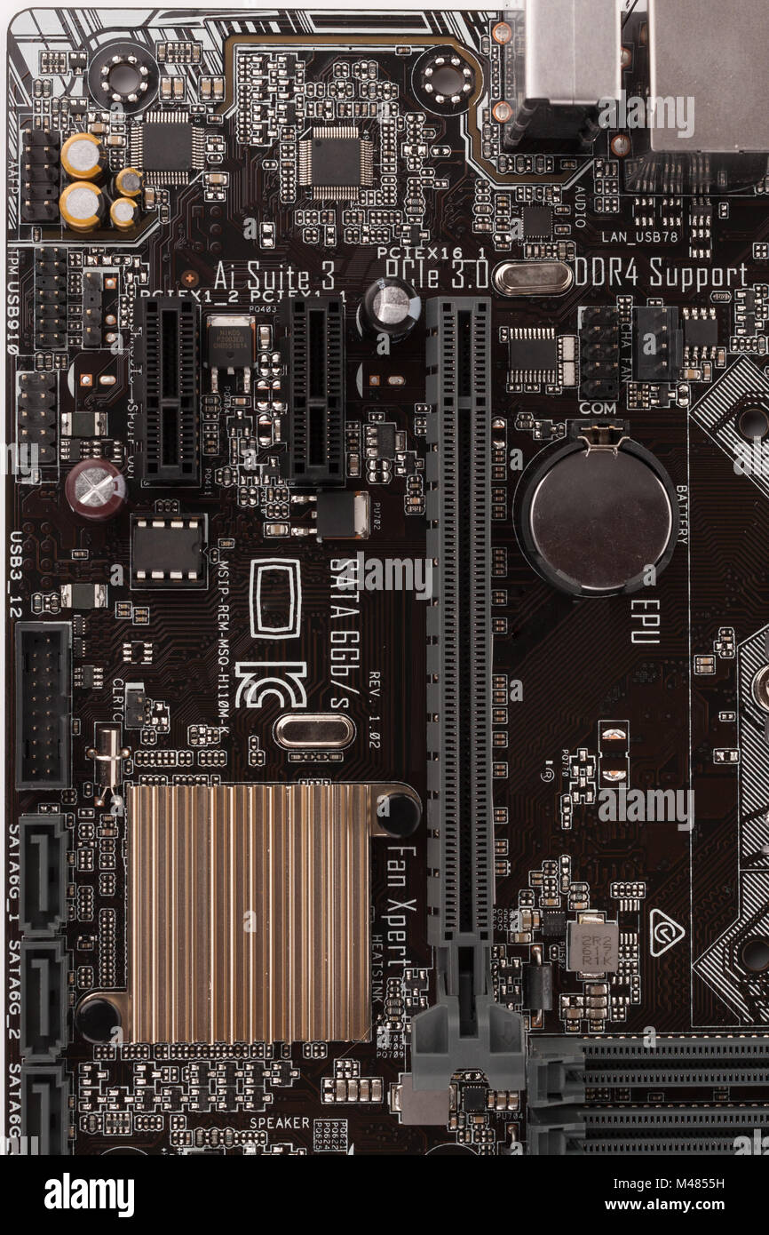 Slot for graphic card on new, office motherboard, close up view. Stock Photo