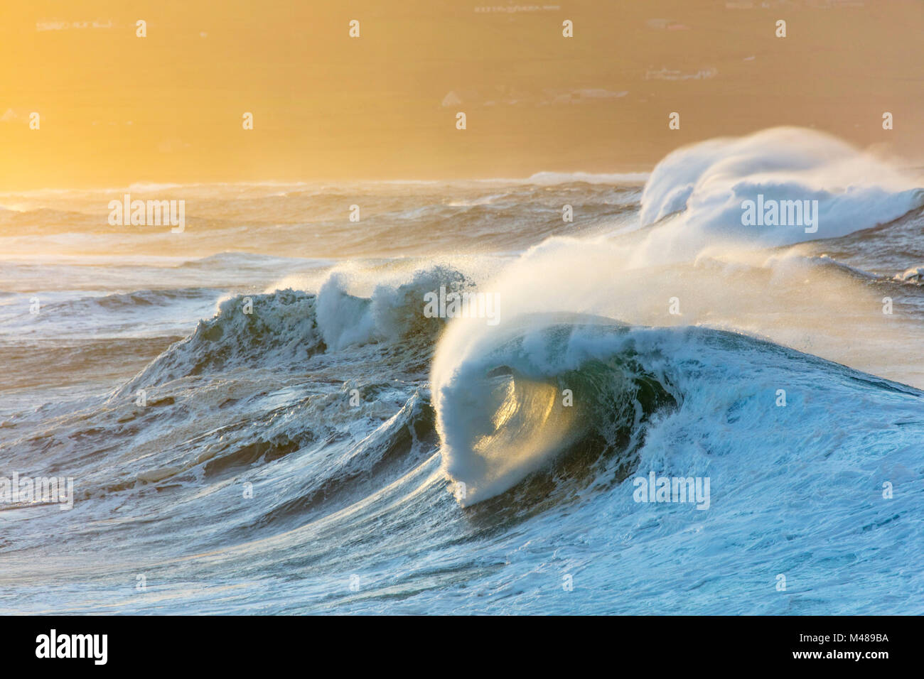 Evening storm waves in Ballycastle Bay, County Mayo, Ireland. - Stock Image