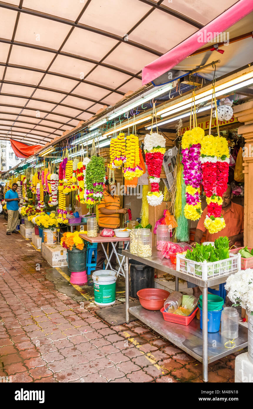 Kuala Lumpur, Malaysia - Feb 7,2017 : Colorful garlands flower selling in the market stalls in Brickfields Little - Stock Image
