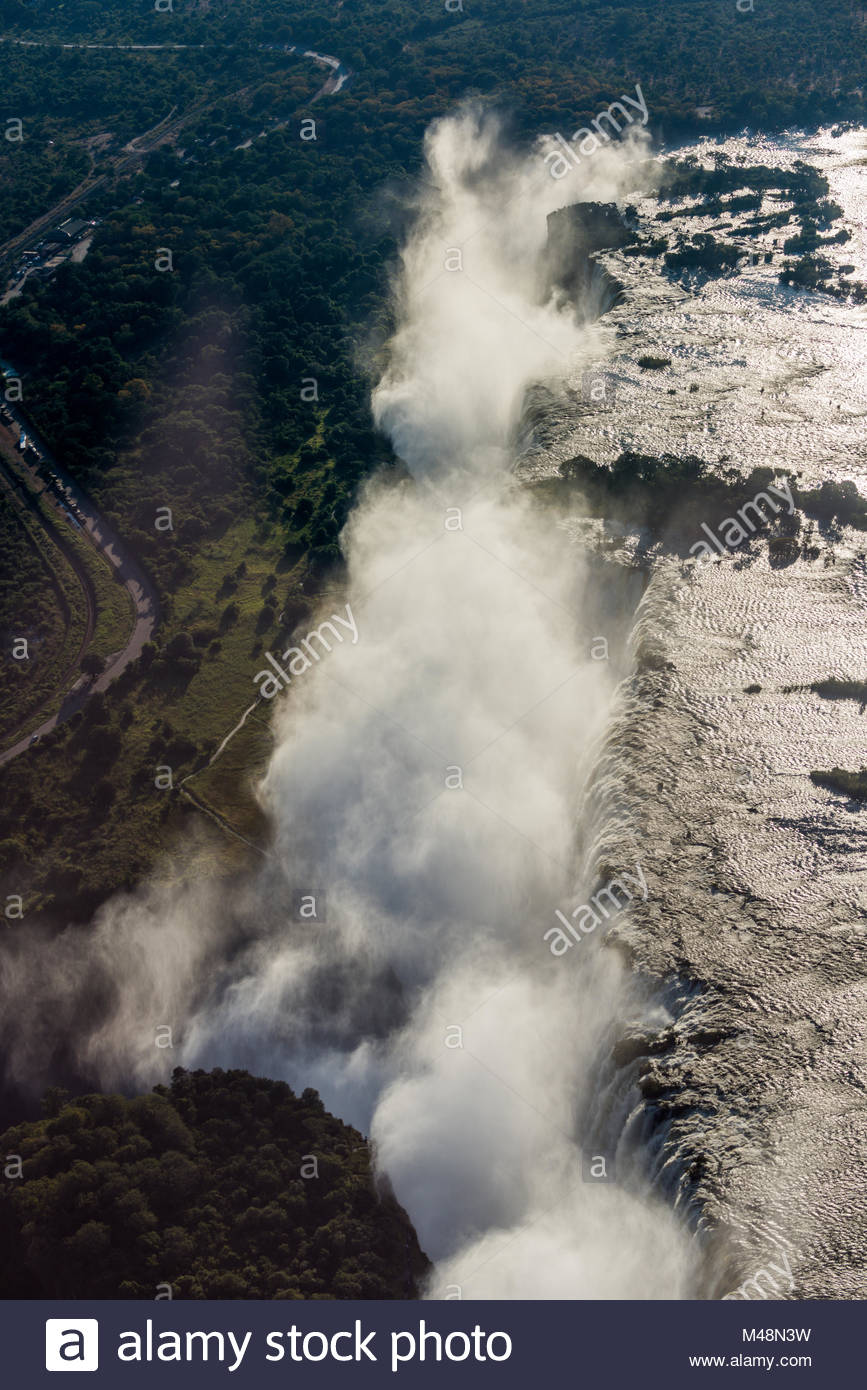 Aerial view of Victoria Falls creating spray - Stock Image