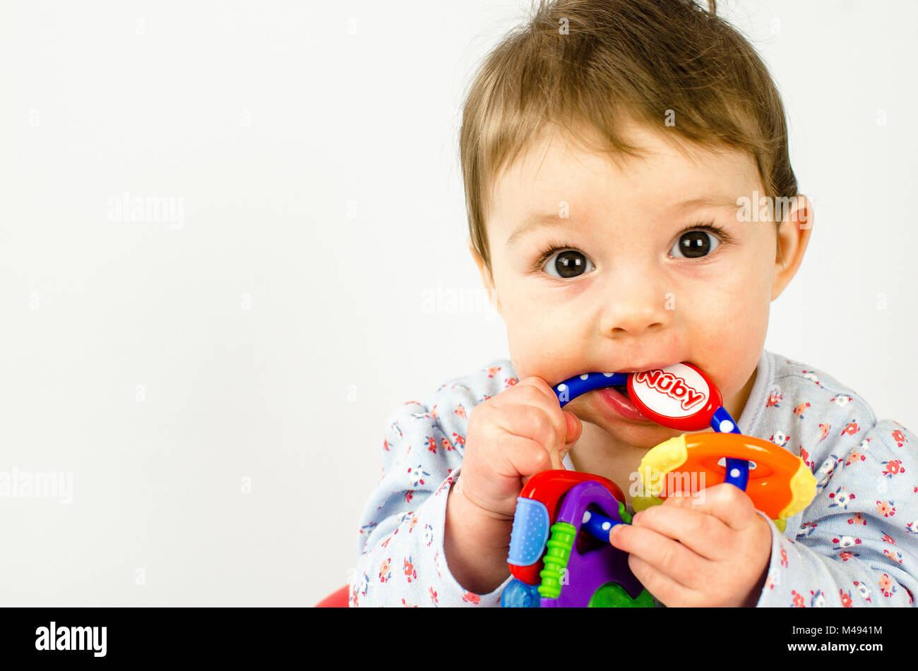 teething baby girl - Stock Image