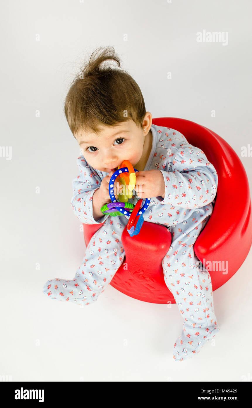 teething baby girl Stock Photo