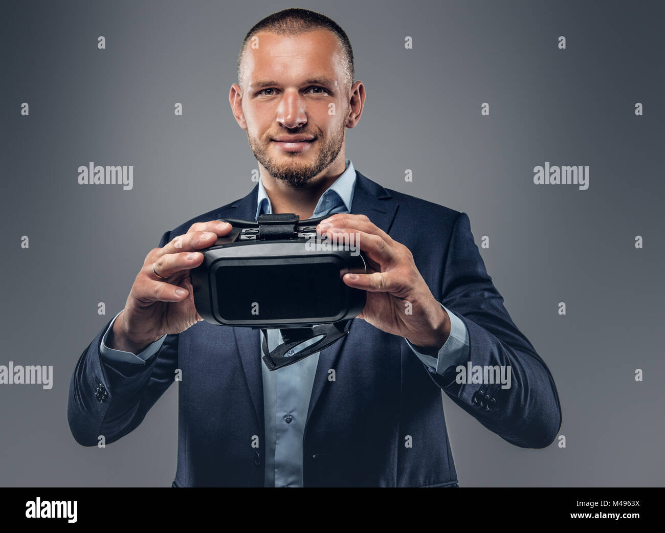 A man showing virtual reality glasses. - Stock Image