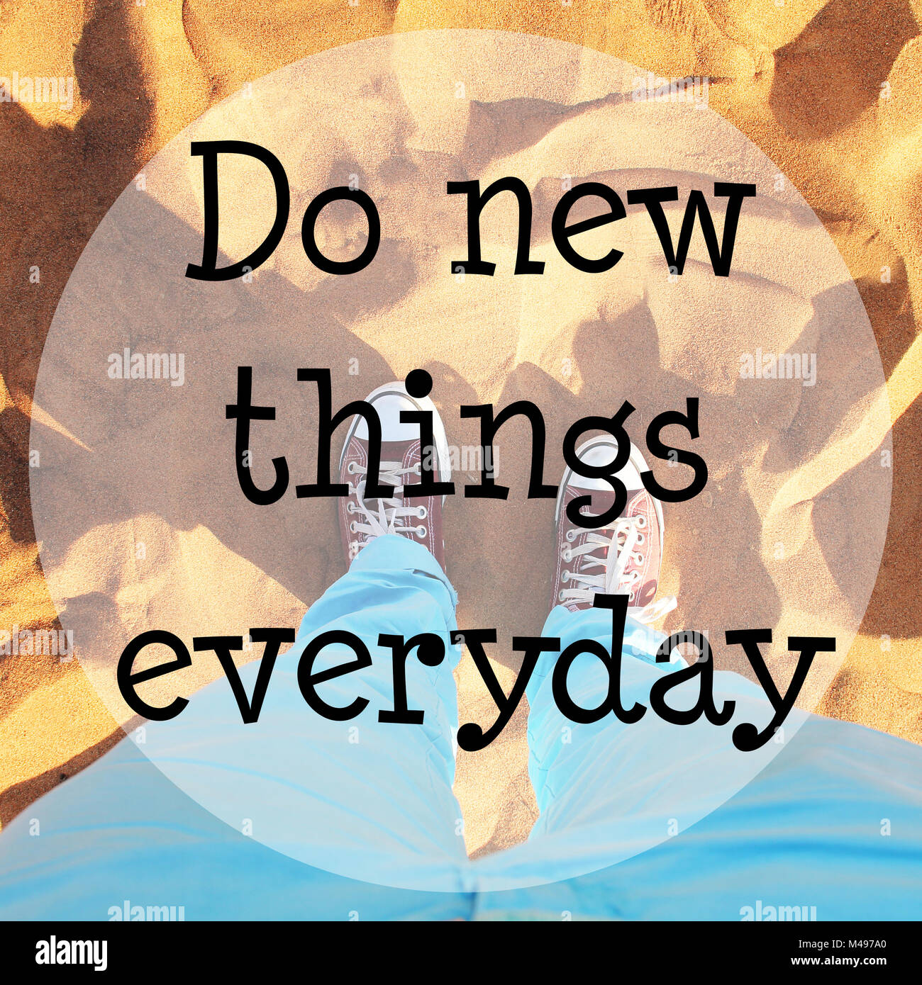 Desert sand with text: Do new things everyday - Stock Image