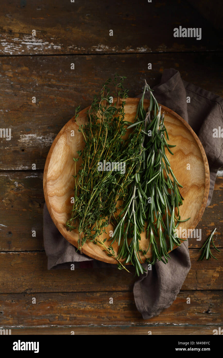 Healhty fresh rosemary and thyme, food above - Stock Image