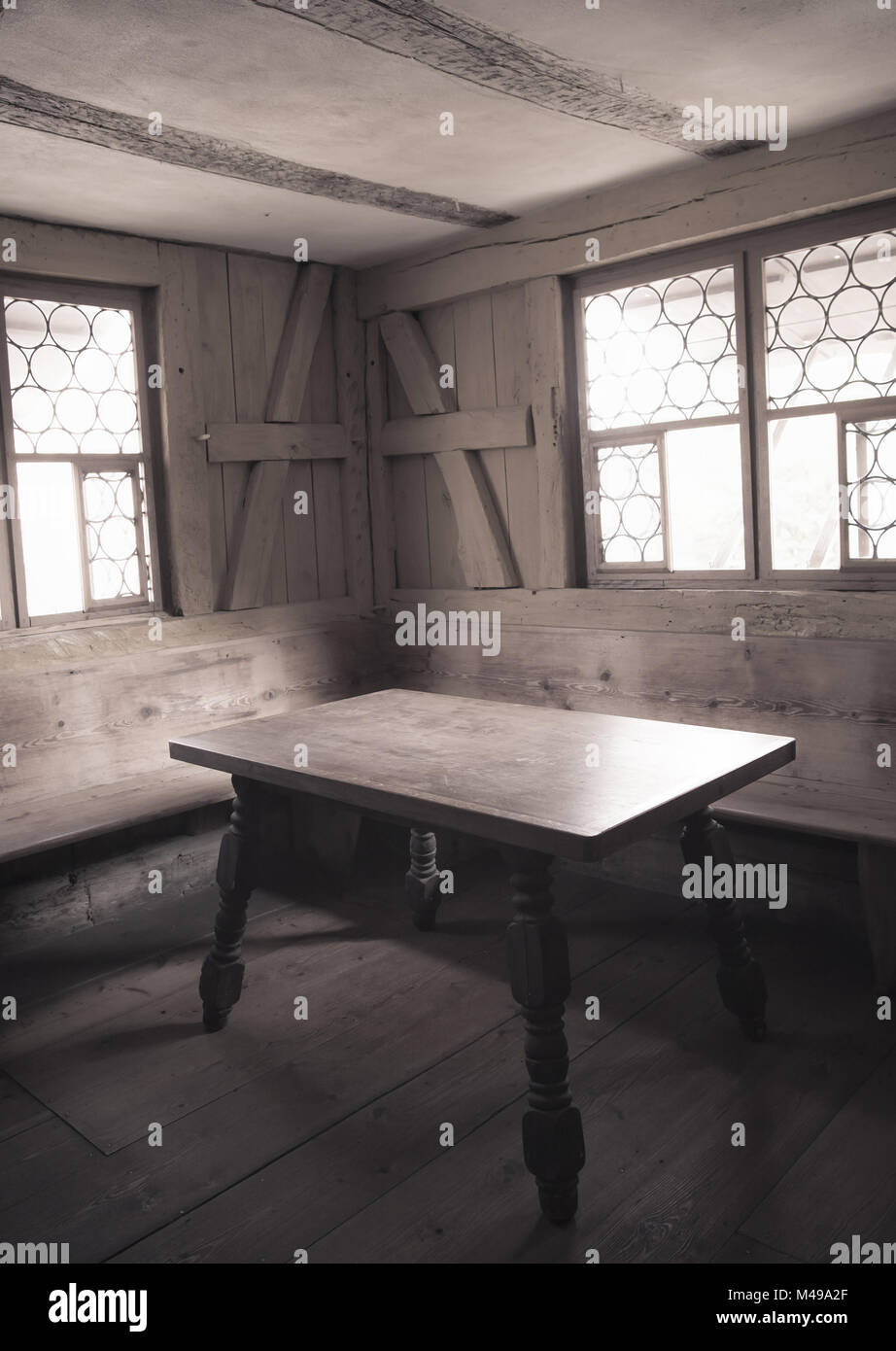 Vintage image of a wooden furnished dining room interior - Stock Image