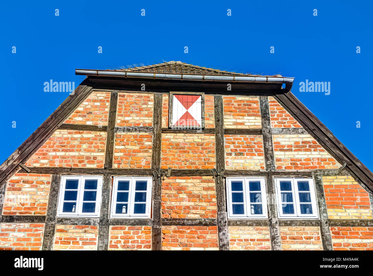 Historic red brick constructed house in Wismar - Stock Image
