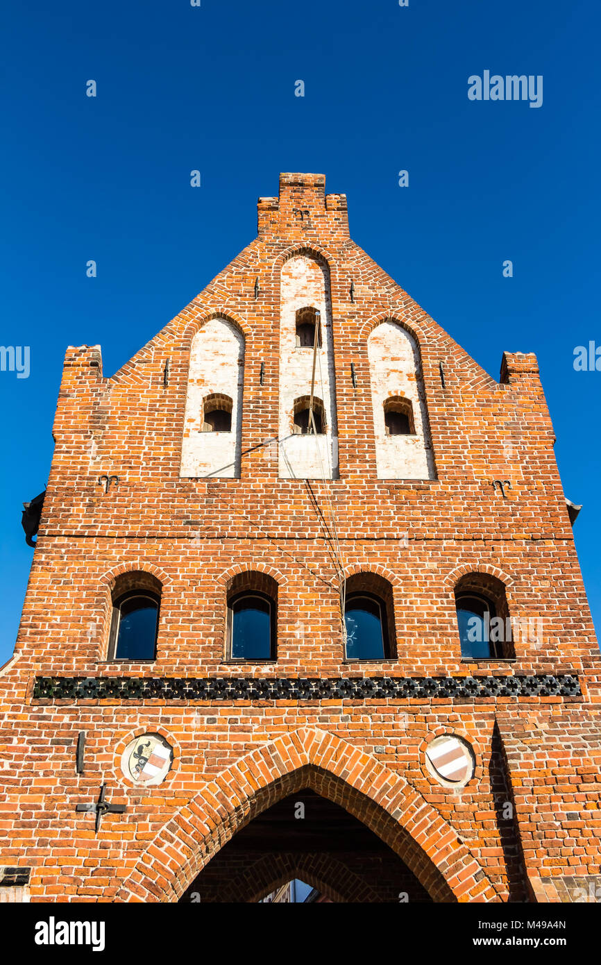 Historic city gate at the old harbor in Wismar - Stock Image