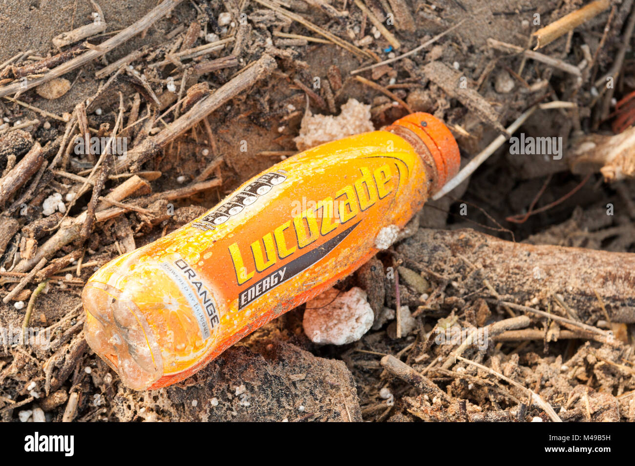 Detritus including a veriety of plastics washed up on Cefn Sidan, Pembrey. West Wales. UK. - Stock Image