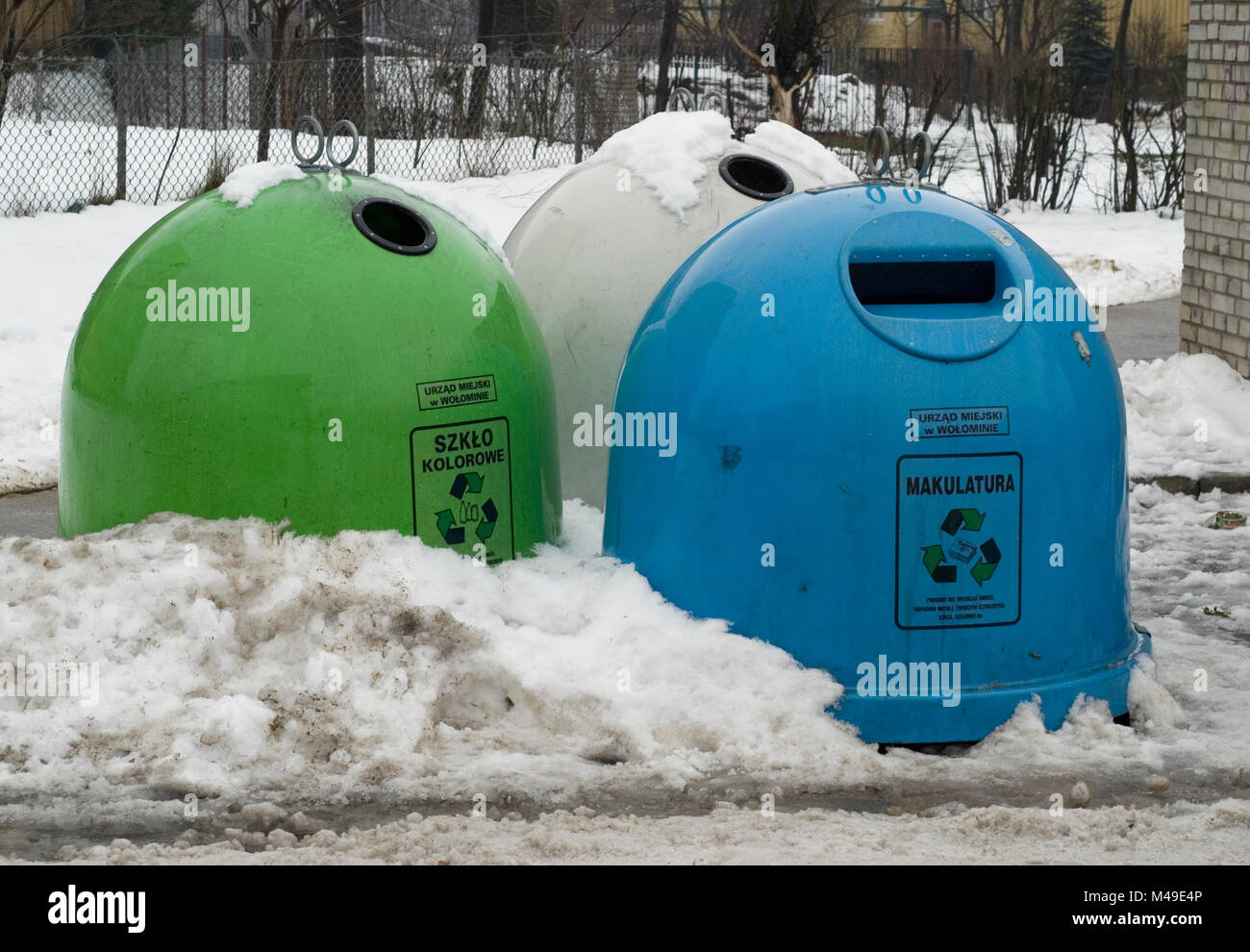 Recycling bins in the town of Wolomin in the eastern outskirts of Warsaw. January 2007 Stock Photo