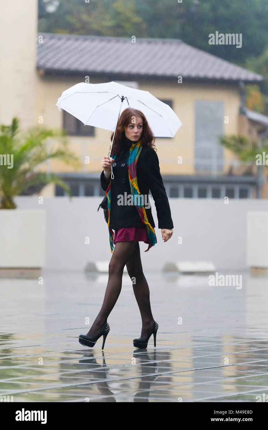Young woman legs heels images alpfabet - Stock Image