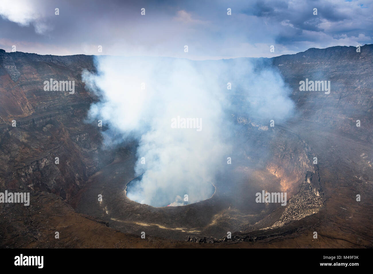 Steam rising from the crater of Nyiragongo Volcano. Virunga National Park, North Kivu Province, Democratic Republic - Stock Image