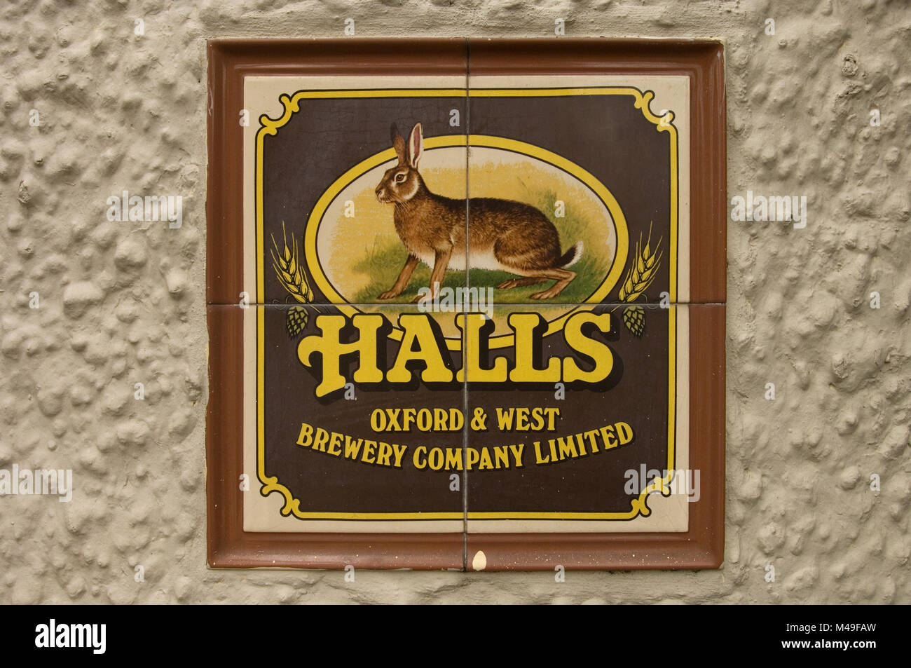 Halls Oxford and West Brewery Company Limited tiled sign on an outside wall of a pub in Oxford, England. 2007 - Stock Image