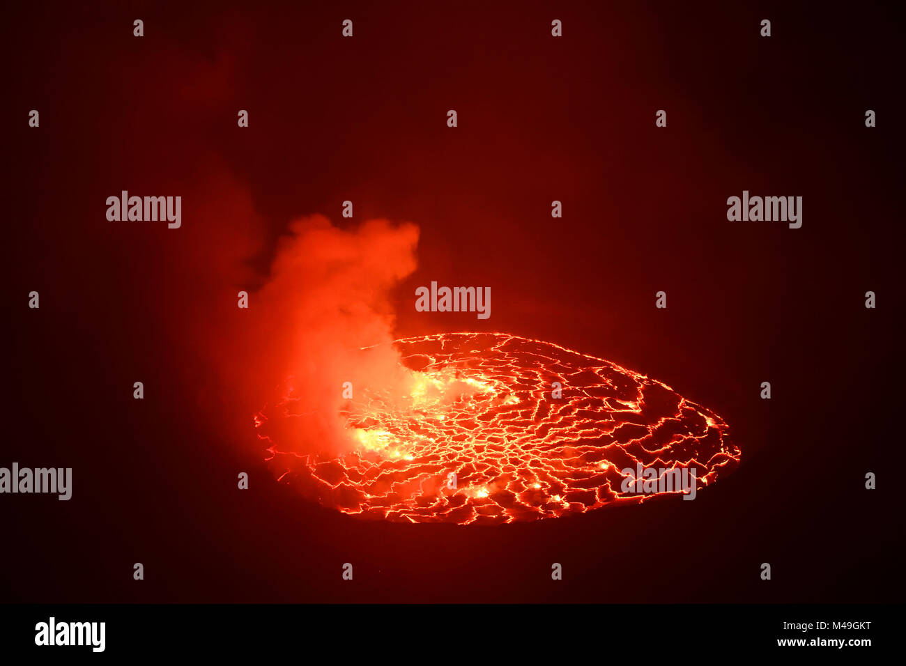 Lava lake at night in the crater of Nyiragongo Volcano, Virunga National Park, North Kivu Province, Democratic Republic - Stock Image