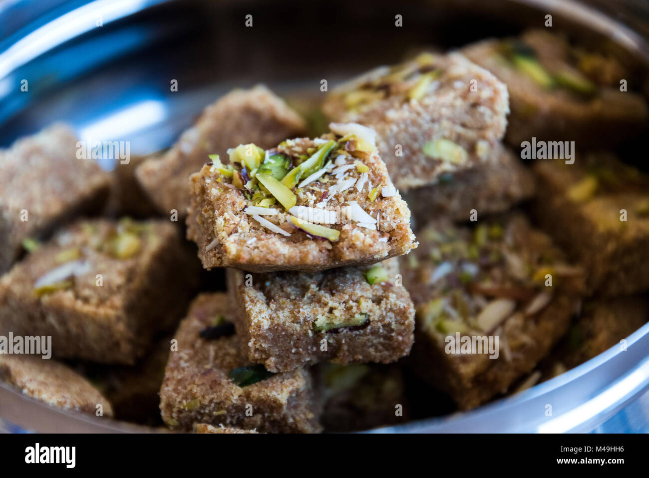 Mohanthal (sweetened gram flour fudges made with Ghee, and flavored with saffron and almonds) a Traditional Gujarati - Stock Image
