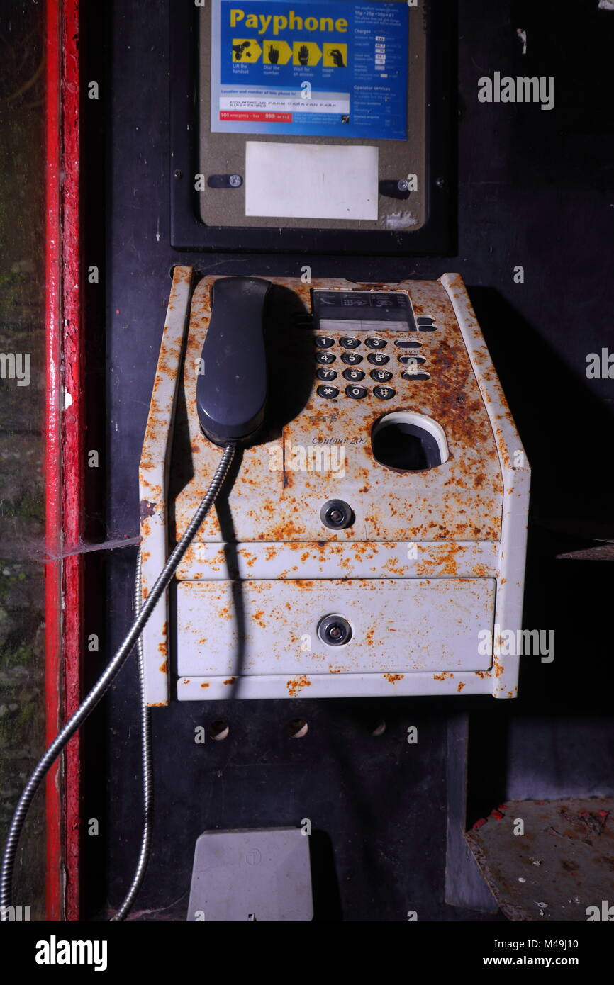 A public payphone inside a K8 type Telephone Box located on a caravan park in Ingleton, North Yorkshire - Stock Image