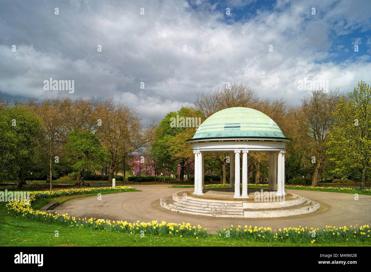 UK,South Yorkshire,Rotherham,Clifton Park Bandstand & Cherry Blossom - Stock Image