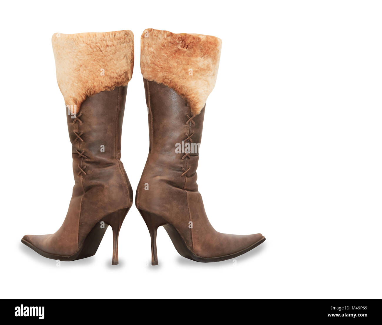 Brown high heels suede woman boots isolated over white - Stock Image
