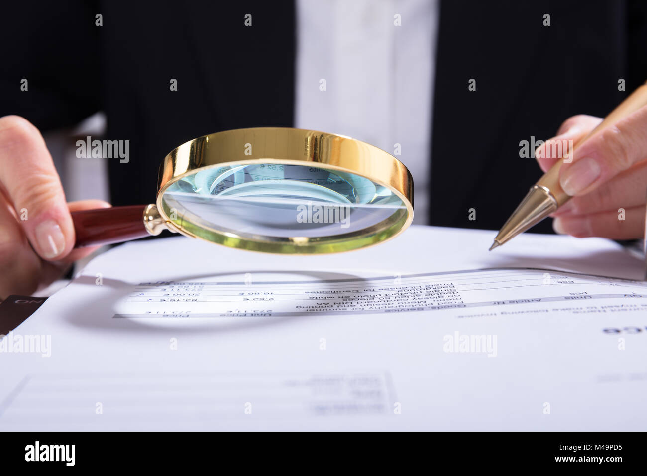 Close-up Of Auditor Inspecting Financial Documents At Desk - Stock Image