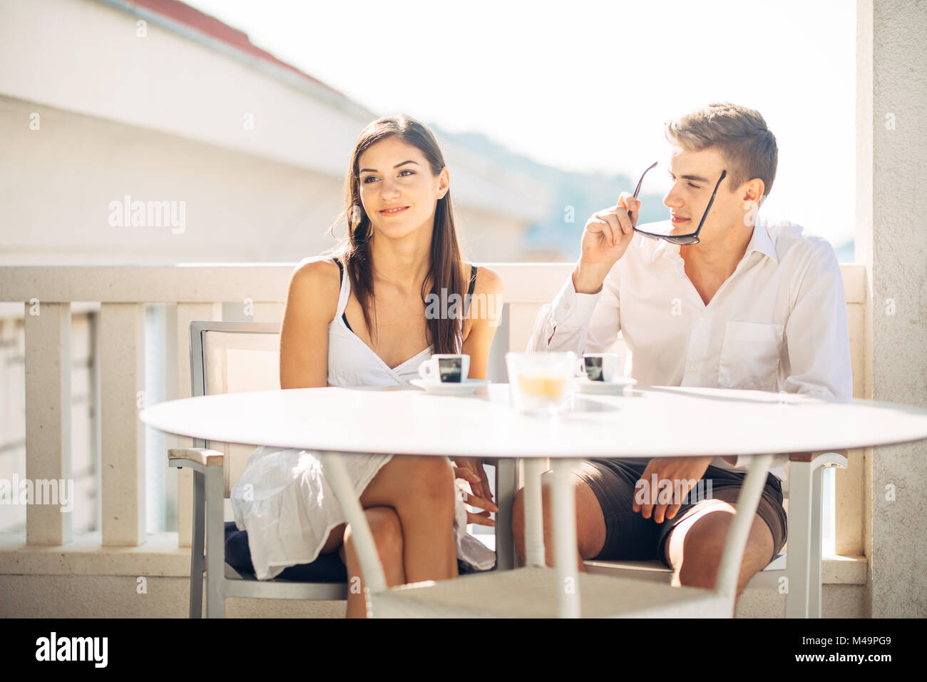 Attractive couple having first date.Blind date.Coffee with a friend.Smiling happy people having a coffee,dating.Getting - Stock Image