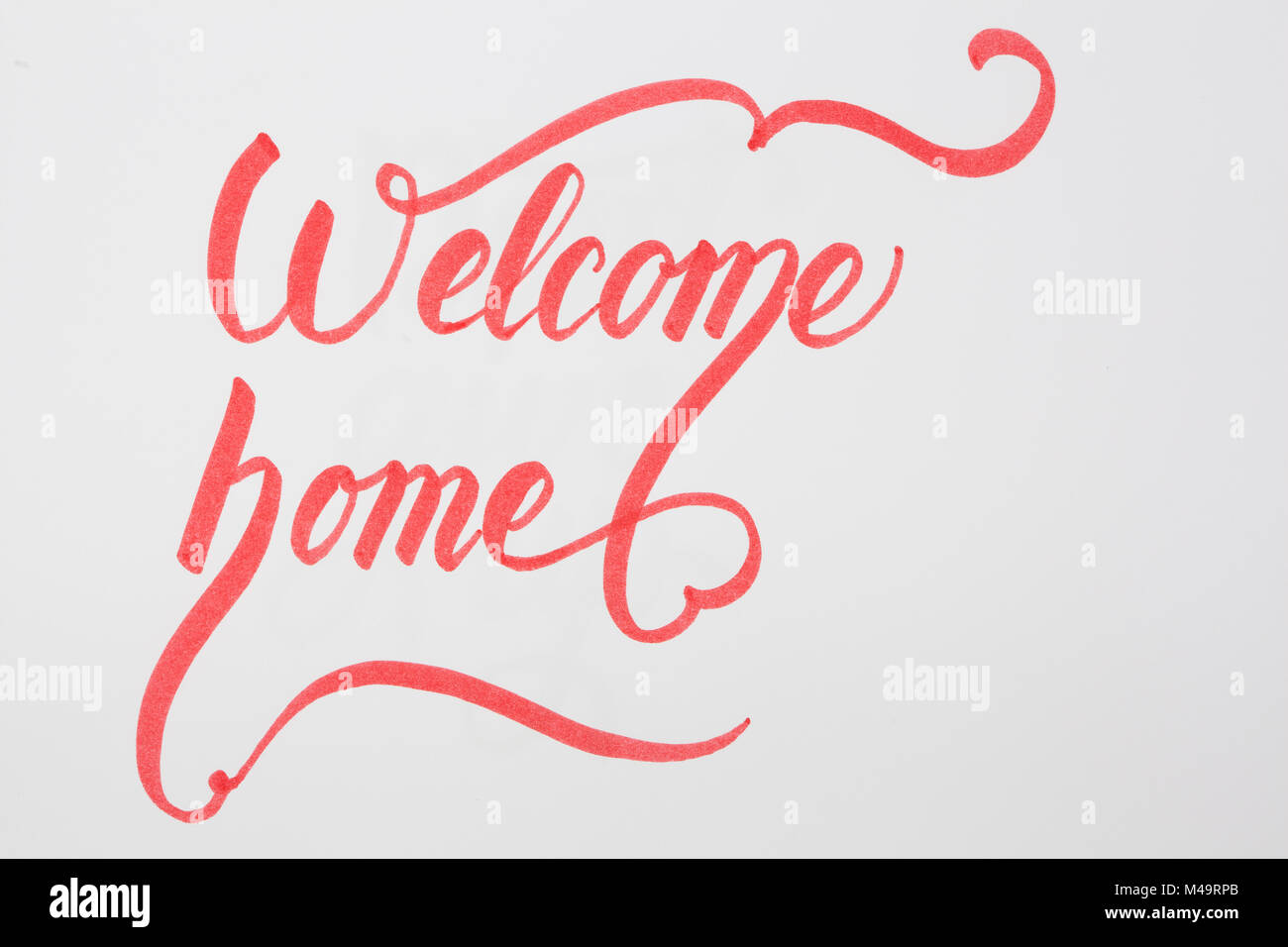 Welcome Home creative brush lettering on white background with copy ...
