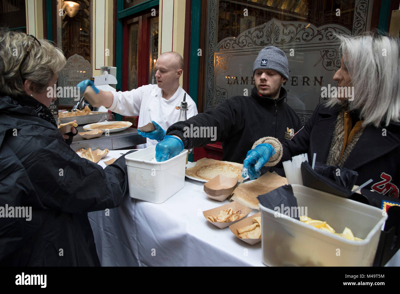 Free pancakes on Shrove Tuesday as festivities warm up for the Leadenhall Market Pancake Day Race on 13th February - Stock Image