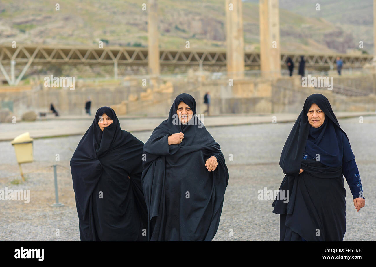 three women in hijabs walk according to the Persepolis - Stock Image