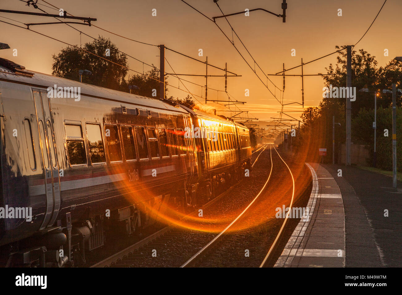 ScotRail train at station, early morning. - Stock Image