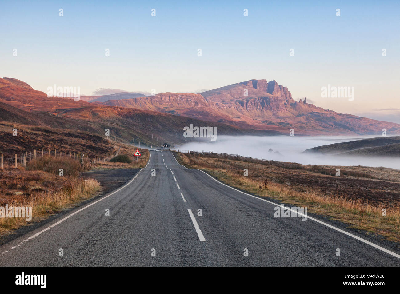 The open road on a misty autumn morning at The Storr, Isle of Skye, Inner Hebrides, Scotland, UK - Stock Image
