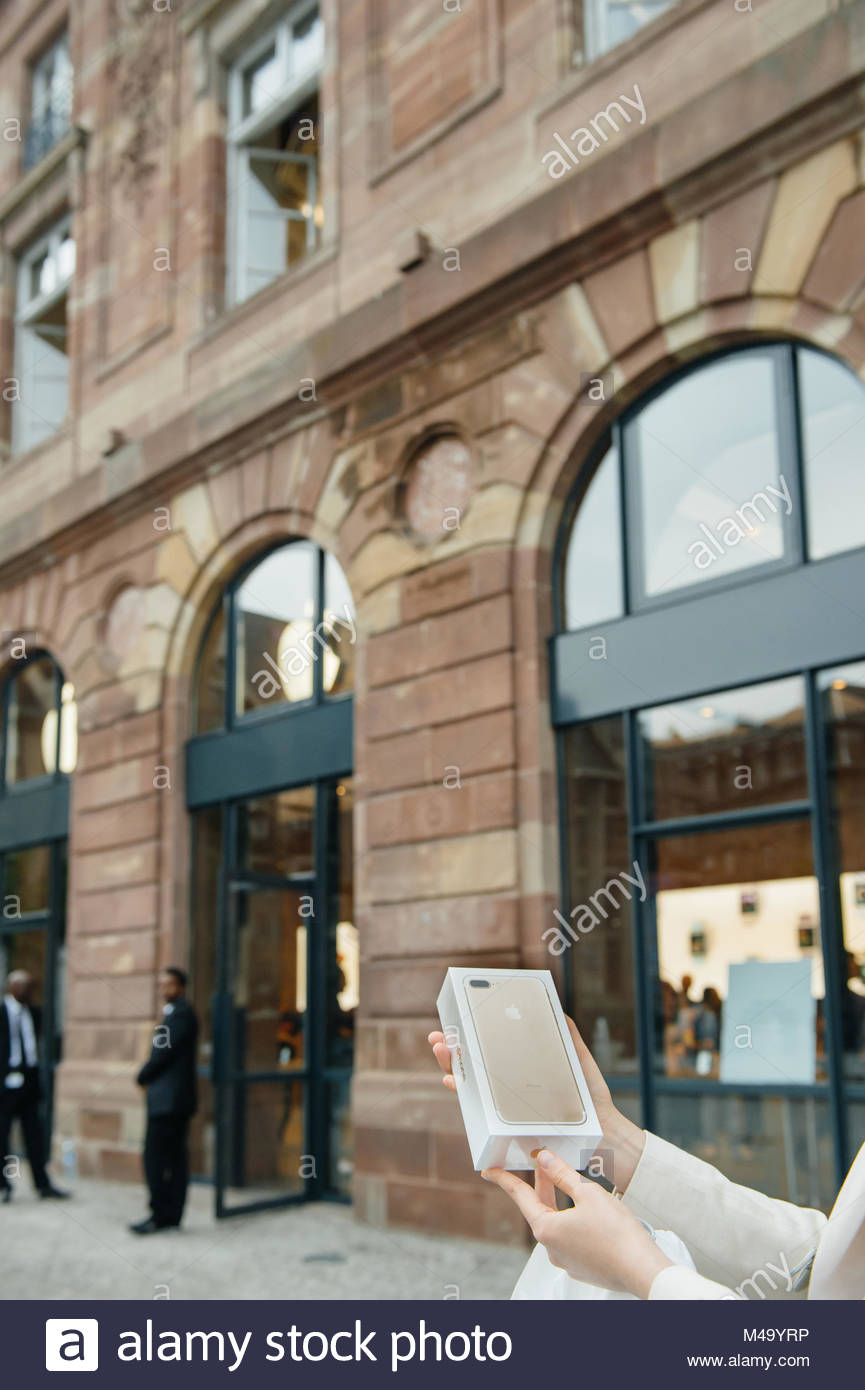 Happy customer after purchasing the new iPhone 7 plus - Stock Image