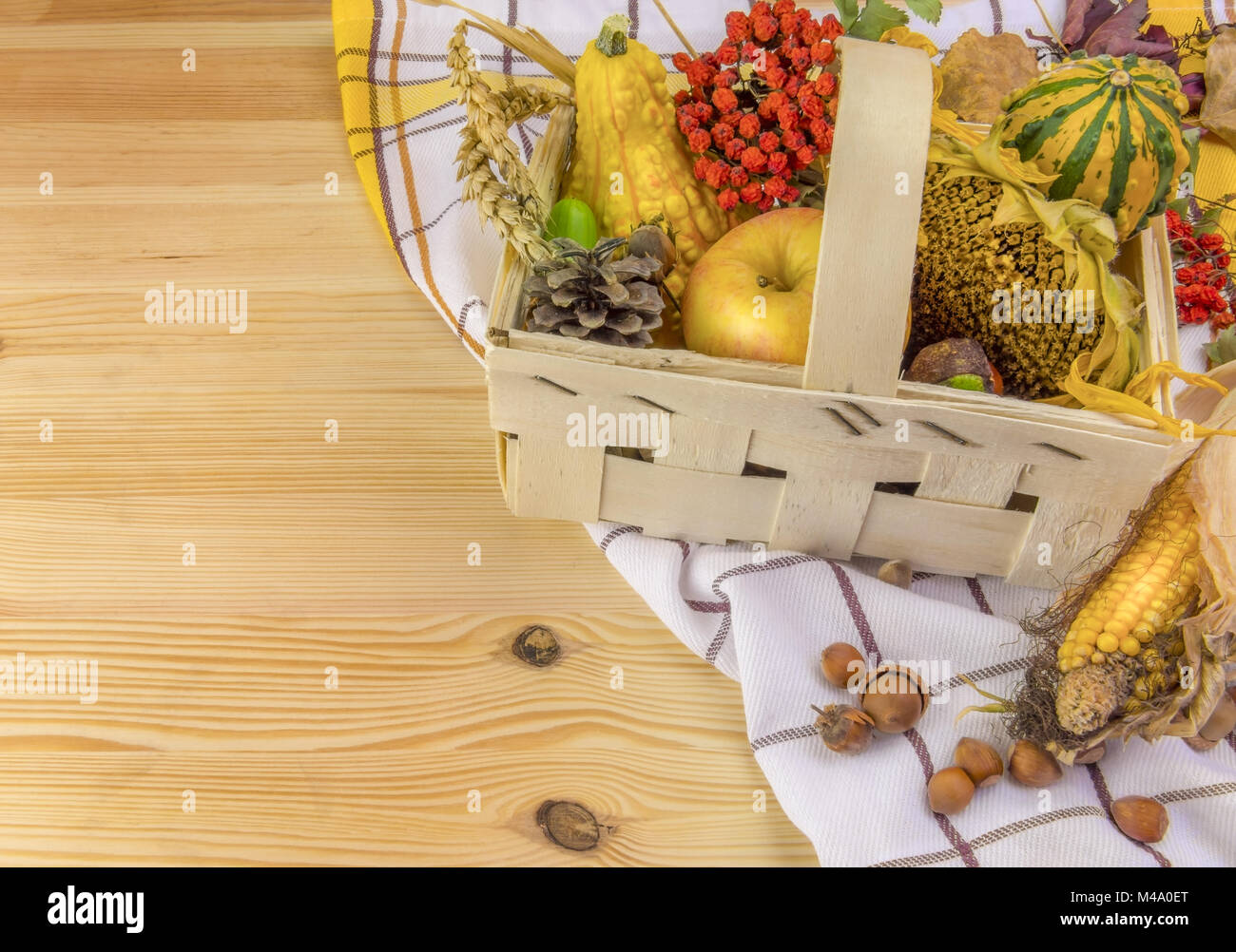 Autumn arrangement in a basket on wooden table Stock Photo