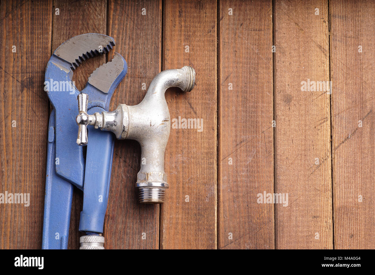 plumber tool faucet for house repair lying on wooden background ...