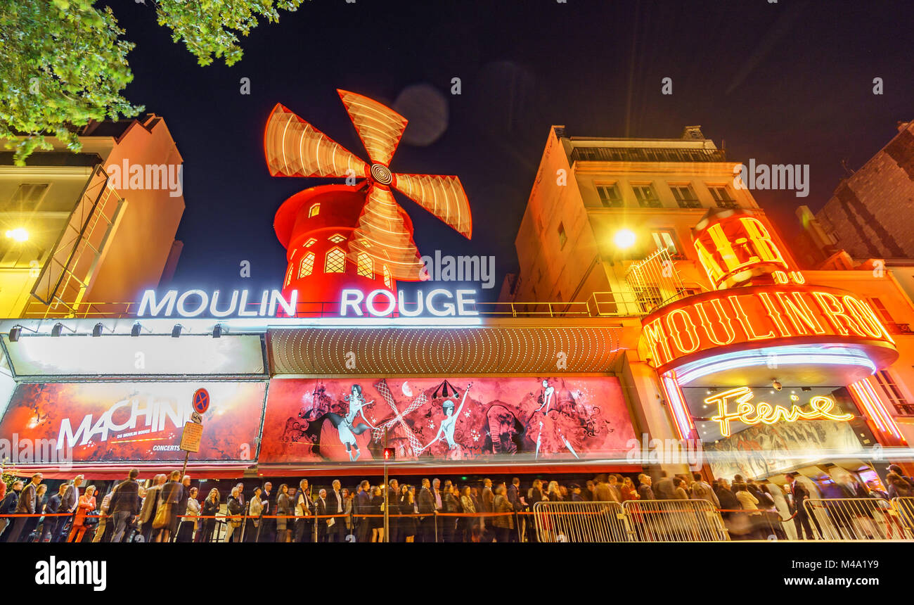 PARIS - MAY 15: The Moulin Rouge blurred motion by night, on May 15, 2015 in Paris, France. Moulin Rouge is a famous Stock Photo