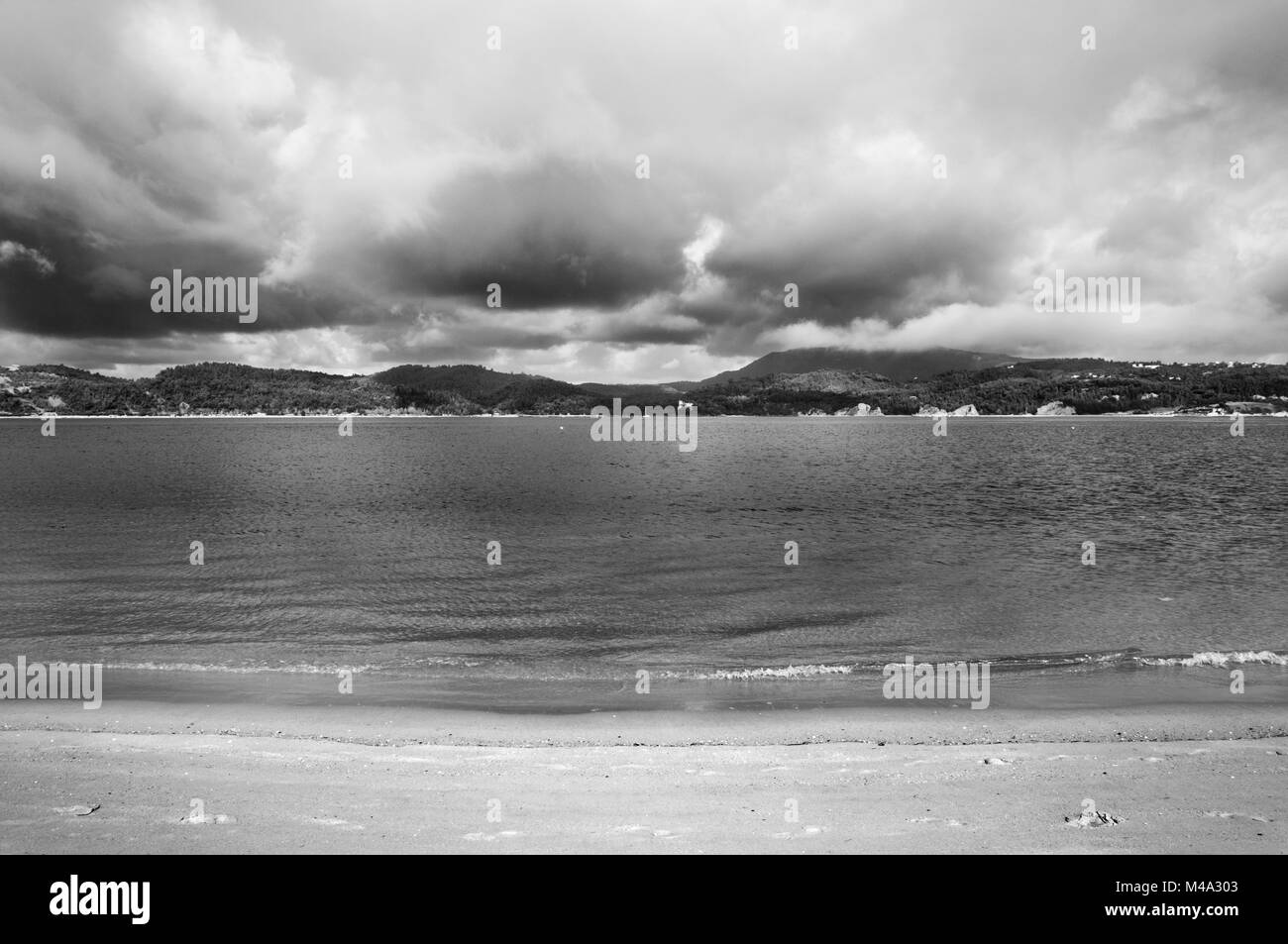 Black and white photograph of the landscape of the beach of the troia peninsula portugal a cloudy day