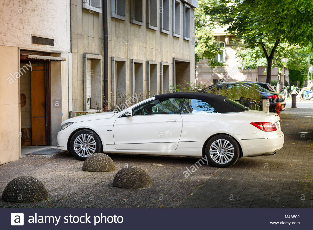 Luxury Mercedes-Benz CLK convertible car entering through garage - Stock Image