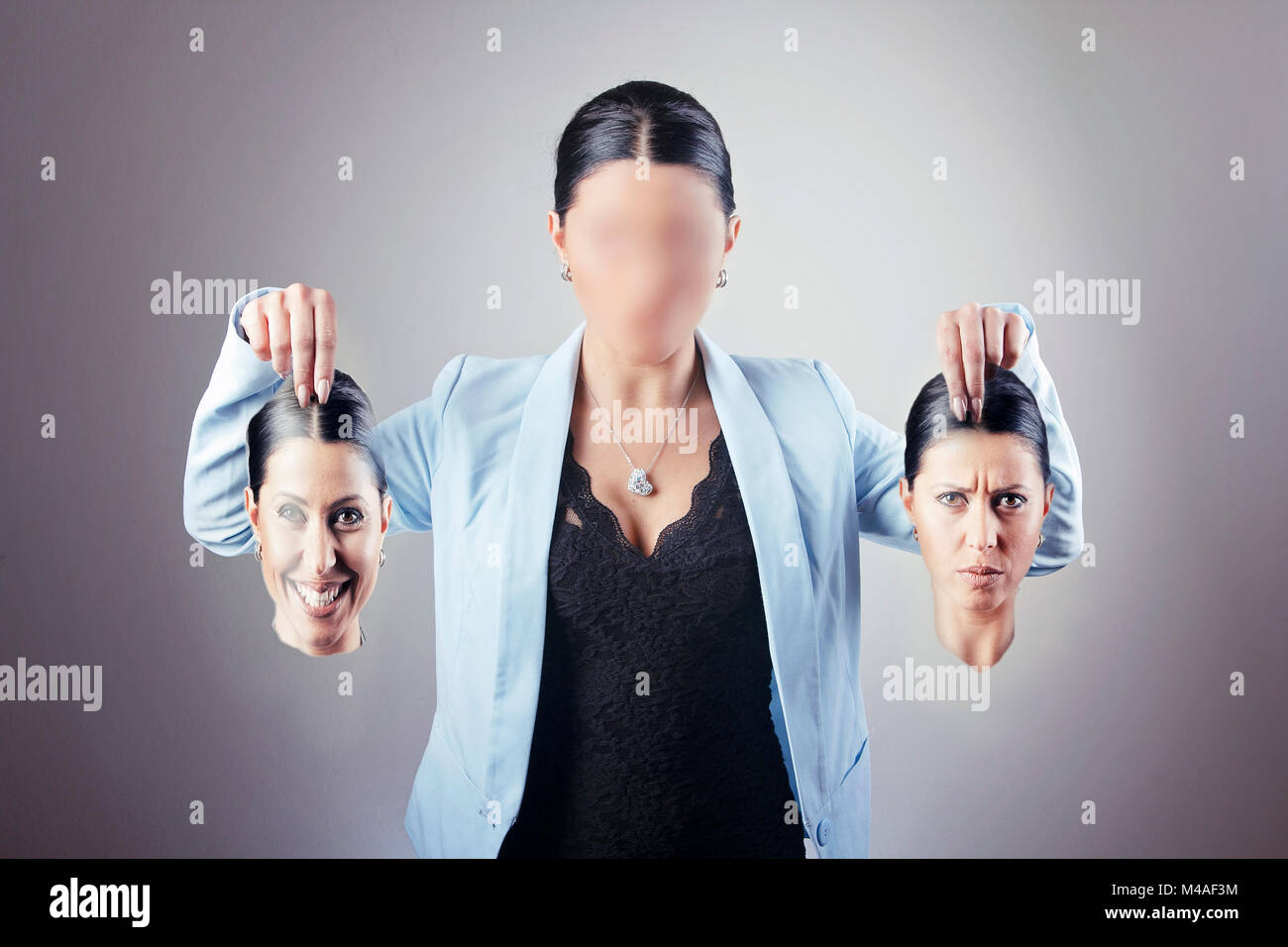 Business woman with the identity disorder - Stock Image