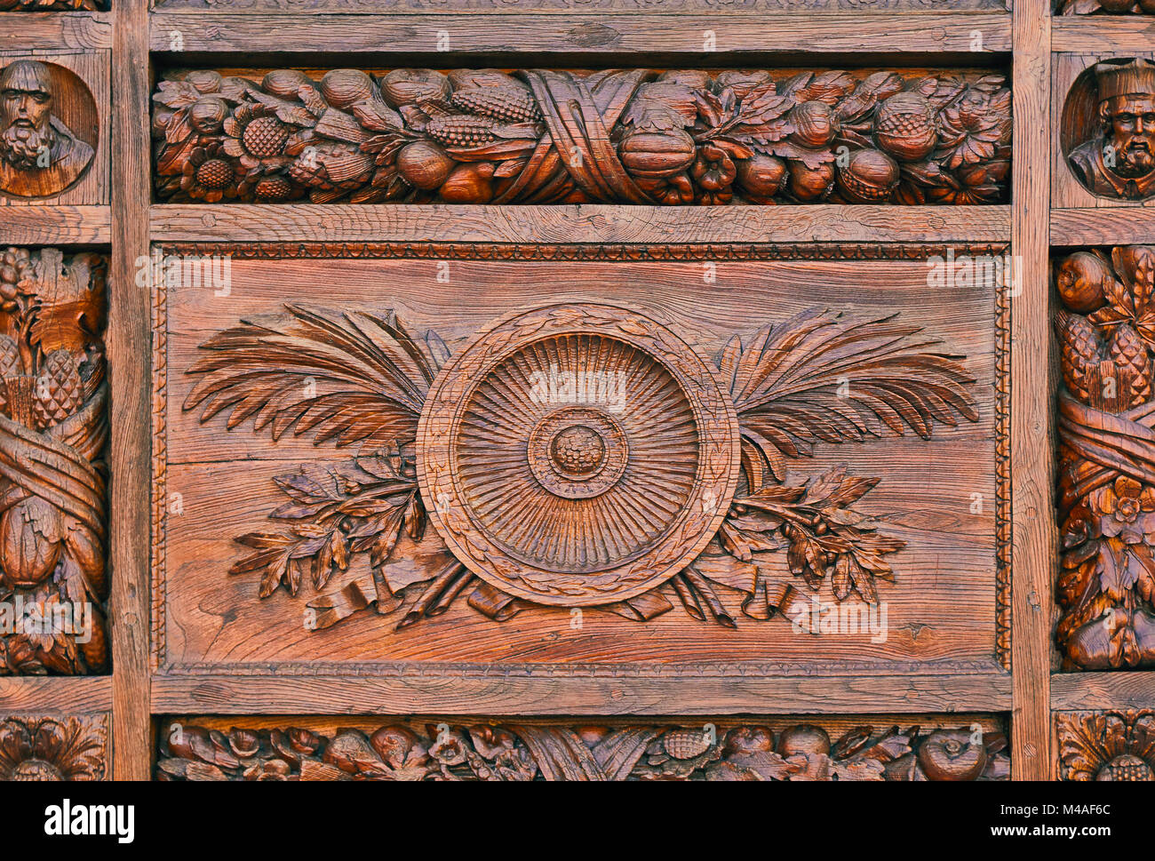 Detail of a carved pattern on the wooden door of the basilica di