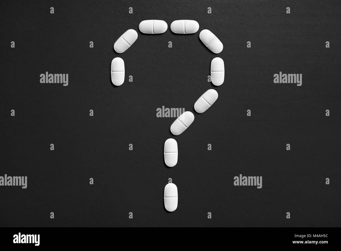 Question mark made from pills. New idea or innovation in science or pharmaceutical industry. Wondering medical issues. - Stock Image