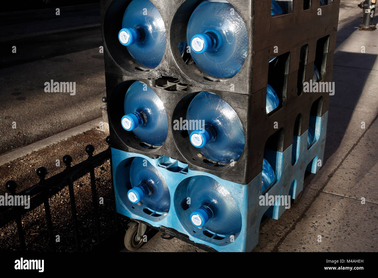 Delivering jugs for a water cooler - Stock Image