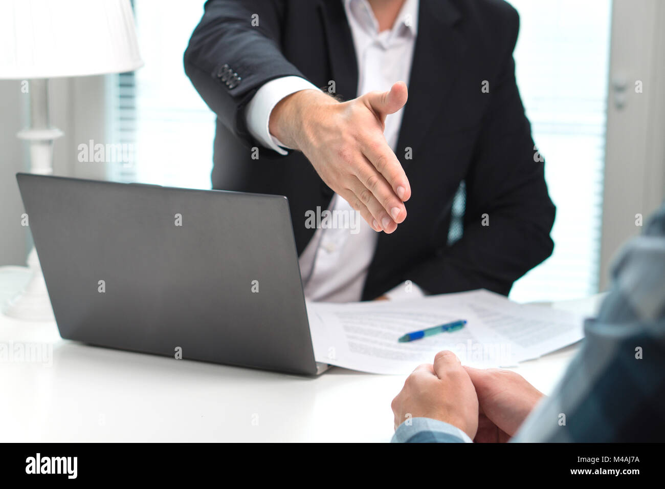 Business man offer and give hand for handshake in office. Successful job interview. Apply for loan in bank. Salesman, - Stock Image