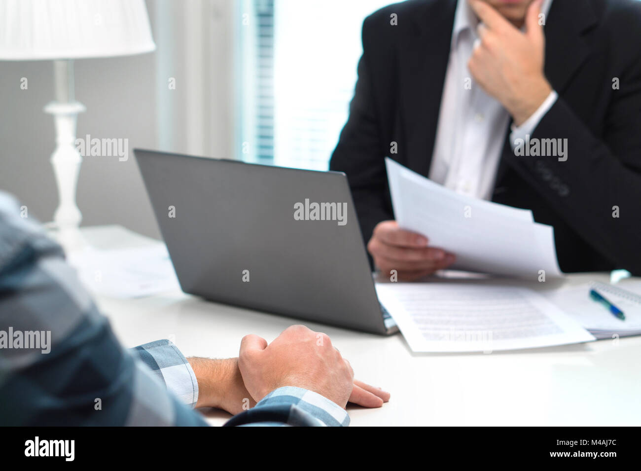Job interview or meeting with bank worker in office. Business man considering. Discussion about loan, mortgage or - Stock Image