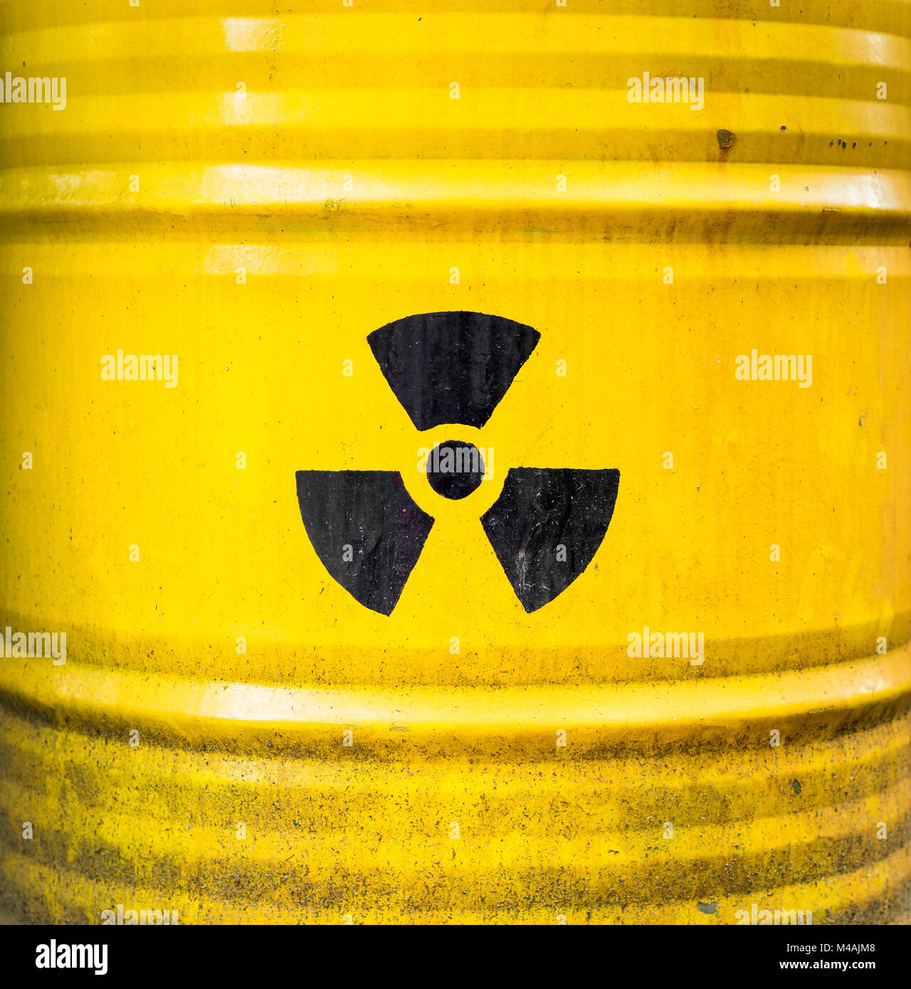 Radioactive sign, icon and symbol on yellow nuclear waste barrel. - Stock Image