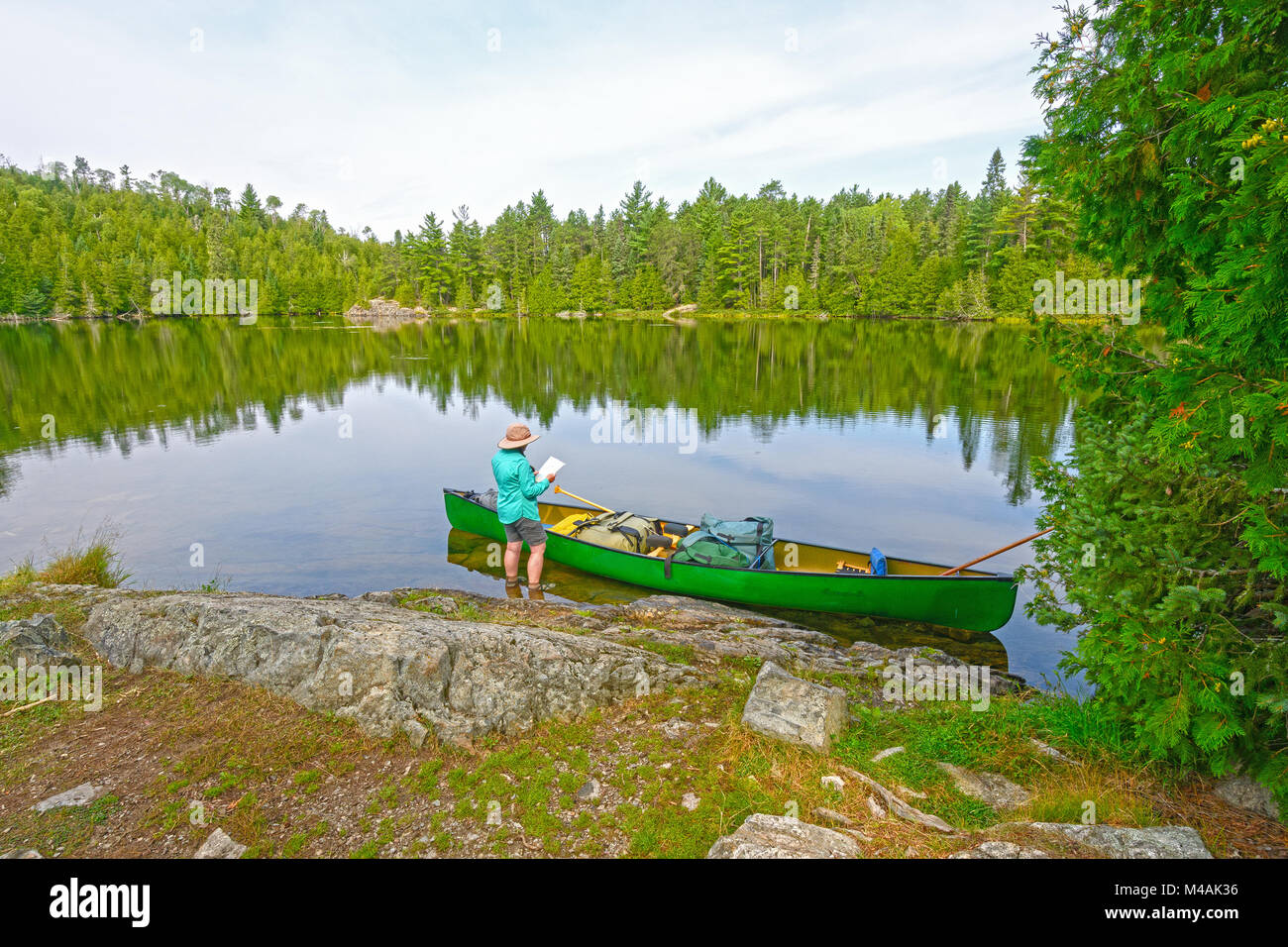 Plotting Your Course into the Wilderness on Ottertrack Lake in the Boundary Waters in Minnesota - Stock Image