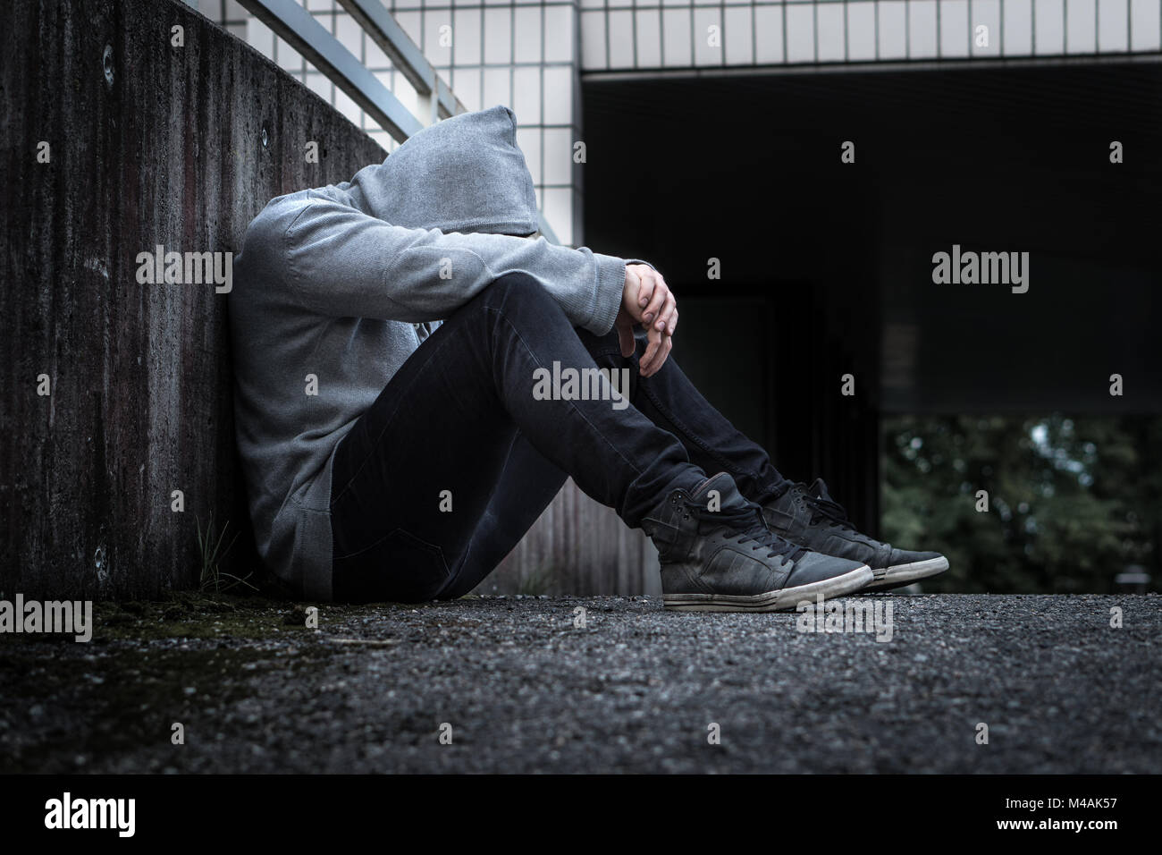 Depression, social isolation, loneliness, mental health and discrimination concept. Sad, lonely, depressed and unhappy - Stock Image
